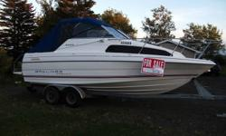 22-5 ft fiberglass bayliner, mercruiser V6 engine 160 hp inboard/outboard, sleeps 2-3, table, sink, head, water tank, cooler, seats 6-8 in excellent condition with twin axle galvanized trailor.