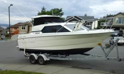 1998 Bayliner 2452. New 5.7 ltr and leg (less than 300 hrs.) New upholstry, headliner and carpets. Bellow, trim sensors, gimble bearing and hoses replaced this year. Set up for downriggers. 9.9 merc and trailer included. This boat is in very nice shape.