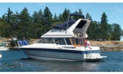 This sedan with a command bridge is absolutely priced to sell.Boat house kept. This model features forward and mid-cabin staterooms with upper and lower helms and is kept in a boathouse. With only 1255 engine hours on the twin OMC mod. Cobra sterndrives