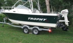 2007 Model 2052 Bayliner Trophy Walkaround. Like new with less than 100 hours of use.   -Cummins 120 hp diesel Inboard with mercury outdrive -Cuddy Cabin -Fish Finder -Depth Sounder -GPS -VHF -CD Stereo -Satellite Radio -Porta-Potty -table     Comes with