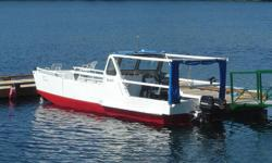 26' Beach Landing Craft.  Steel hull. Aluminum upper structure. 2 outboards 35 & 45hp mercs. Two side doors & wide front drop gate. New floor in rear with bilge access & two bilge pumps. Self bailing front deck. 50 gallon main fuel tank. You can run it up