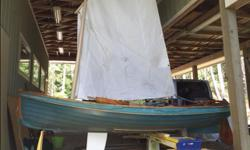 Beautiful dingy comes with sailing rig and two rowing stations. Wood / hull / rig in excellent condition. Does need a sanding and a paint job otherwise no issues. Located Salt Spring Island.