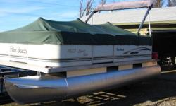 2003 Palm Beach Cruise and Fish 18,5 foot with 1996 Evinrude 40 H.P. , live well , 2 front swievel fishing seats , L shape back bench with table , bimini top ,fish finder , in great running and good looking condition , No Trailer but can help with
