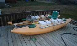this is a great little fishing Canoe.  Set up for two people and comes with two paddles and four ice chest.  Great deal for the price.