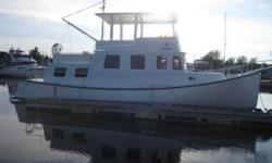 42 ft fibreglass pleasure boat. 135 Perkins engine, 10 kw diesel generator, diesel furnace, fridge, stove, microwave, 2 heads, bathtub, sleeps 6-8, flybridge. Price 89,000 or nearest reasonable offer. Serious inquiries only. Call Karl (709) 535-2878.