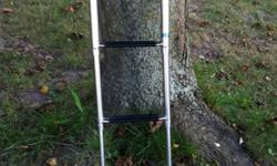 Universal boat ladder - fits most boats. New & never been used.