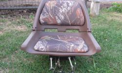 One blue and white seat, 25.00, one CAMO seat new with adjustable attachment for attaching to bench in boat 50.00
