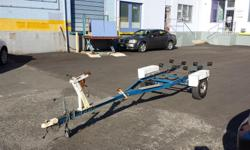 Boat tralier with rollers.. unique stainless steel side steps makes it easy to stand on while loading boat in the water. Fits boat up to 16foot Ready to go has papers currently insured.. *can deliver if you dont want to insure right away.. have transfer