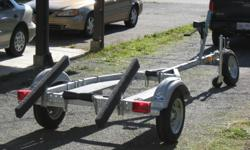FOR SALE   Brand New 1250 lb. EZ Loader Galvanized Boat Trailer It will take a 10' to 14' Boat Extra's Include:    Balanced Tires Plus a Spare    Back Roller    Walk Way Both Sides    Front Trailer Jack                               $900.00   Phone: