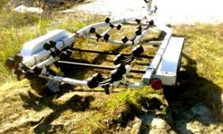 Northtrail dual axel trailer in good condition with the exception of rust on the axels and a little around the the frame. Previously held a 19.5 foot boat and has tail lights in working order. Rollers in good condition, trailer rated for 4000 lb. Asking