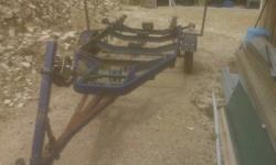 Boat Trailer for sale.  Refurbished rims with new tires. New bushings, coupler latch, lights(1). Repainted fenders with ss bolts. Tilt.  Needs proper rewiring but lights work as is.