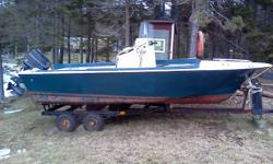 Center console 17 foot fiberglass boat with 75 evinrude, trailer, Volvo Penta controls.