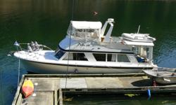 Beam 12ft. 6in, Draft - 2ft. 6in. 1967 Fiberglass Hull, twin gas motors, Well maintained. Fully canvased. Enclosed Command Bridge. Wood Cabin Interior, Walls - Teak, Head Liner - Vinyl, Broadloom Carpet, Teak cabinets, For and Aft Heads. Modern