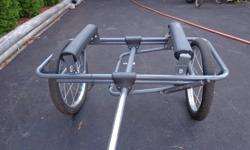 Cart easily attaches to bicycle's rear hub. Detach with quick-release levers. Straps are included. Cart frame is light weight anodized aluminum and stainless steel hardware. Rugged inflatable tires. Cart wt. 20 lbs. Can handle items up to 15 ft. long /