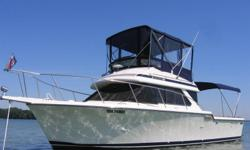 Delivered new by Gregory Marine in Detroit and berthed at the Windsor Yacht Club since new. Fly Bridge seats 5 comfortably. - 34 ft overall with 11 ft. 9 in. beam. - upper and lower dual command stations - twin 350 cu. in. closed cooling system Crusader