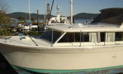 This is a classic 1968 Fiberglass Chris Craft Sedan style Commander with original twin Chevrolet 327 gasoline engines. The boat is direct drive. This is a project boat, partially completed. All the top glasswork has been refinished and the cabin