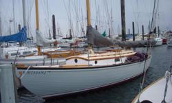 """Near Wooden Boat Show ready, the 1939 Sea Witch , Ed Monk SR. design, 29'7 LOA wooden hull, 8'8"""" beam 4'5"""" draft, gas engine. Mast has been revarnished with 9 coats of Captains Varnish and bottom painted last October. Includes 2 jibs and jenny. This offer"""