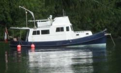 Converted Tug Yacht - Otter      40' Steel Tug built 1954 converted to cruiser live aboard. Stainless double sink, stainless fridge, propane stove, Antarctic Dickenson Heater, separate shower tub, pedestal sink, vanity, king size V berth, large salon,