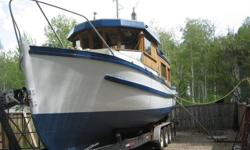 36 ft trawler converted to cabin cruiser. Oak and cedar hull in excellent shape, fully self contained, bathroom w/shower, galley w/ frigde, stove, berth below wheelhouse,  patio doors, 6 cly Perkins deisel engine- aprox. gal/hour. Solar, genset, shore