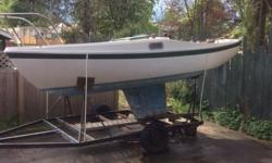Solid sailboat with trailer for storage and launching. Heavy construction and keel makes for a safe and stable boat with balanced sailing manners. Similar to Cal 20, same designer and builder. All rigging and 2 sails, large cockpit seats 6. A great