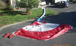 Red and White Nylon Cruising Spinnaker with sock and sheets.In perfect condition, used only three times. Sold the boat. 0.75 nylon, I=37.5, J=11.25, 645 sqft (60 sqm)