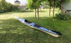 This popular model kayak is in good used condition, it is a nice dry fibreglass boat. This is a 2001 model, made in Canada. If you are a veteran kayaker you will know how popular this model is - if you are new to kayaking this would make a great first