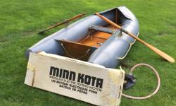 10 foot zodiac style inflatable , comes with pump, wooden oars, 36LB. Minn Kota , this inflatable has a wooden floor.