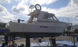 26 ft+ Glasply Sportsfisher. Twin Cummins 3.9 Diesels, trolling valves on both engines. New fuel tank New paint New shafts and seals. Cabin and cockpit controls and steering. Cabin Heater. Electric flush toilet Scotty electric Downriggers and pot puller.