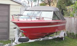 Grew I/O boat and trailer with 165 Hp Mercruser engine; an excellent engine. Includes Lowrance Mark 5 Pro depth finder, covers, paddles, anchor, Auxiliary motor bracket. VHF Marine radio