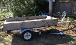 EZ loader boat trailer. New bearings last year. It had my 16ft Lund aluminum on it but sold that and currently has a 4'x8' box on it. Rail runners are still on it for a boat.