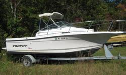 """2002 21"""" cuddy cabin trophy, comes with a full enclosure, a 2002 150 2 stroke salt water series mercury, a 2002 escort trailer, the boat has a GPS, Fishfinder and VHF. It has washdown, hydraulic trim tabs, and a wet well. It has dual batteries with"""