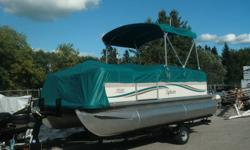 "Attractive, 18'3"" pontoon boat, Model Mirage CRS 818 by Sylvan. Comes rigged with Bimini top, Full playpen cover, windscreen, docking lights, built in fuel tank,and boarding ladder. Included is a Mercury 40 HP 4S Big Foot Outboard motor. Full warranty."