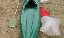 """This is a super light, mark 4 kayak made of kevlar (what they make bullet proof vests out of) and fiberglass.  This is a river touring kayak without a keel.  Comes with 2 dry storage bags, neoprene skirt and paddle.  I am 6' 2"""" and 190 lbs and use it"""