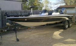 Price Reduced on Rare Fisher FX-21 Tournament Bass Boat & Trailer.  It's in nice shape for a '97.  It needs nothing and is ready to fish.  The hull is in great shape as well as the carpet.  Comes with a 24v 67 lb Thrust Motorguide Trolling Motor up front,