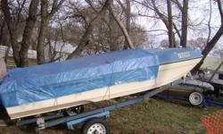 this trailer is 16ft. blue in color, tire size 5.30-12 4 hole rims, the boat is 14ft, fiberglass VANGUARD, has 2-5gal. tanks, new battery, has a 65hp. mercury 650 motor, motor has new shifter and new water pump, new lower leg. new tan tarp for boat ,