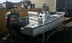 For sale : Key Largo 166 center console with 115 Mariner outboard and an aluminum I-beam trailer , Boat comes equipped with ,, compass , bilge pump ,  eagle fish finder , oars , anchor and two marine batteries , bimini top. Electric tilt and trim .