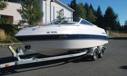 Beautiful Fourwinns 205 Sundowner in exceptional condition. 150 HP Johnson Ocean Runner Outboard. Bought new in 1997. Stored indoors in the off season. Newer EZ Loader Trailer with disk brakes and LED lights. Multiple tops: Camper Back / Slope Back /
