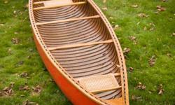Cedar Canvas Peterborough Canoe for sale.   16' long, newly restored.     This narrow and fast boat has been lovingly restored to it's original Peterborough red.  Interior was completely refinished with new cedar gunwales added.     Age unknown but was