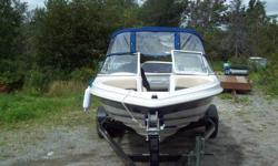 2008 Mercury Cruiser 17' Fiberglass speed boat, full canopy wrap around, and trailer, with colored fishfinder/GPS