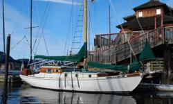 This is a professionally designed and built 35 ft inboard auxiliary cutter rigged sailboat with carvel planked wood construction. Hull is yellow cedar on oak frames and decks are marine plywood overlaid with teak planks. This classic has been Cowichan Bay