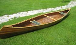 handcrafted cedar canoe, like new condition, comes with two new paddles, asking $1250, located in Kippens.