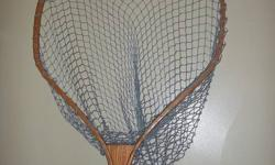 """Hand made Oak Fishing net. Net 22""""x 20"""" and 24"""" in depth. Net consists of 3 laminated strips 1/8 x 1"""" each . 5 coats of marine lacquer. Shaft is 65"""" in lenghth overall length is 85"""". Removable Brass bolts to inter change net."""