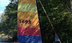 Hobie Cat 18 sx w/wings. Hulls need a bit of care, but has been sailed the way it is with no problems. No soft spots or warping. Good tramp. Main has a small tear (repairable) 2 jibs, Roller jib, Hotstick, Mast head float. All running rigging replaced