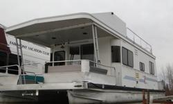 1998 40ft Sumerset Envy Houseboat for sale with a 2008 Yamaha 50 hp High Thrust outboard. Roof was professionally replaced and flybridge added in 2010. Screened in front porch added in 2009. Stored out of the water every winter. Well maintained and