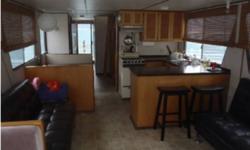 -48 Foot Houseboat -Aluminum Pontoons -Fiberglass + Wood Upper deck -2 Bedrooms -Full Bathroom -Inboard Motor