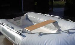 Zeppelin Yankee RIB.  1996 10' rigid bottom dinghy.  Hypalon is the most durable material available for inflatable boats, add on a rigid fiberglass hull and it combines to make a nice sturdy boat.  Planes quick and easily and is rated for up to 15HP