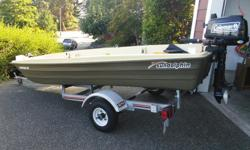 American 12 by Sundolphin - This set up is only a year old and barely used. 2-person fishing boat with seats Built-in motor mounts, rod holders, battery storage locations and extra storage area Lightweight, easy to row Meets CE and US Coast Guard safety