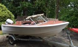 Vintage 16' K&C Thermoglass boat, 60 hp Johnson 2 stroke, 1992 EZ Loader trailer. Good candidate for restoration, or rehab as the boat and motor both need work. Trailer is good. Deep V makes this a rather seaworthy little boat.