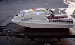 i have a stand up jet ski for sale. was on the water this past summer. runs good and is very clean. its got a 300cc single cylinder in it and runs on mixed gas. fun little toy. comes with trailer which was made for jetski or can be used as a utility