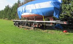 If you have a big boat, this trailer is for you. The cradle is built right in the trailer. The sailboat under the tarp in the picture does not go with the trailer.Air brakes and ready to roll.